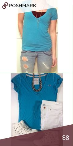 Blue Hollister V Neck Tee Aqua blue Hollister V neck t-shirt. This would fit a small just fine! Hollister Tops Tees - Short Sleeve