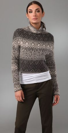 *  Vince Crop Intarsia Sweater This cropped, Fair Isle wool sweater features a rolled edge at the turtleneck. Long sleeves.