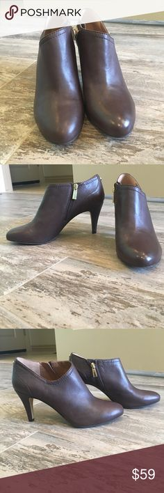 Vince Camuto booties Dark roast colored leather with inside zip!  Has a bit of a hidden platform for comfort!  Yes, they are comfortable! Fit true to size! New never worn! Vince Camuto Shoes Ankle Boots & Booties