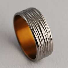 The Sphinx Titanium Ring (shown anodized in bronze) by RomasBanaitis on Etsy.