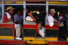 Local bus, Colombia Passengers ready to take a ride on this well-ventilated local bus.
