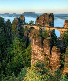 Bastei Bridge, Germany - is a sandstone walking bridge connecting rocky peaks above the Elbe River in Germany. The bridge is located in the Saxon Switzerland National Park in the Elbe Sandstone Mountains, very close to Saxon Switzerland Places To Travel, Places To See, Travel Destinations, Wonderful Places, Beautiful Places, Amazing Places, Beautiful Scenery, Stunning View, Amazing Things