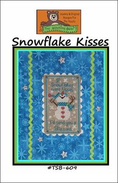 Snowflake Kisses is the title of this cross stitch pattern from The Stitching Bear that is stitched with DMC threads.