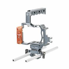 "Cage Kit for Sony SK-A7C1 is a portable aluminum cage kit built for the Sony A7, A7S, A7R, A7 II, A7R II, A7S II which adds protection, stability and mounting options to the camera. It includes form fitting camera cage, wood grip, top hand grip, micro HDMI adapter cable, HDMI plug protector, quick release base plate, cold shoes, 1/4"" and 3/8"" mounting points etc. The form fitting camera cage allows full access to the camera's controls, buttons, battery and SD card slot. The cold shoes, 1/4""…"