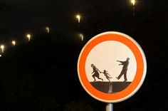 Road sign at Croatia, Rijeka, Kozala Cemetery. Prohibited from acting as a zombie scaring people :-)
