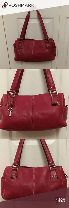 """Fossil Red Pebbled Leather Shoulder Bag Roomy Lightly used beautiful red and silver Fossil pebbled leather, roomy shoulder bag, hand bag purse. Very clean, two small end pockets, 2 large outer sides with magnetic close, middle zip area has 2 pockets + zip pocket. Leather is in superb shape only three small lighter color area. Measures total height top of handle to bottom approx 17"""" x 13L x 4 1/2""""D.  I can still smell the leather. No pen marks, so clean, great dark rich red color. Fossil Bags…"""