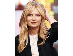 The 21 Best Haircuts with Bangs  / Kirsten Dunst center-parted long bangs seamlessly blend with her layers.