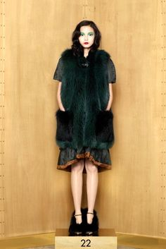 See the complete Louis Vuitton Pre-Fall 2012 collection.