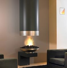 #Modern fireplace with coal #rocks and a cylindrical top cover