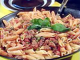 Peasant Pasta by Rachel Ray.  I cannot tell you how many times I have made this recipe.  It is great for a crowd since it doubles well.  It has such a unique taste, it is simple and everyone loves it.  Add some garlic bread, a salad and you have a party!