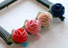 Gabby -  Wool Felt Flower Hairbow or Headband Set of Four Newborn to Adult you choose the clip/headband and the size. $25.00, via Etsy.