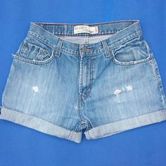 """Levis high waisted shorts size 30""""w Levis high waisted shorts size 30""""w they do have a little stretch best fits size 5/7. Distressed cutoff shorts ( I do stitch the cuffs so they don't unfold) Levi's Shorts Jean Shorts"""