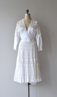 Vintage 1980s super soft white cotton jersey dress with white cotton crochet shoulders, deep V surplice bodice, slightly elasticized waist and full cotton crochet skirt. Belt loops and side zip closure. --- M E A S U R E M E N T S --- fits like: small/medium bust: 36-44 waist: 26-29 hip: