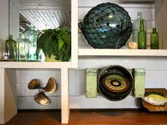 www.coastalvintage.com.au Coastal Vintage decor - old glass float, green bottles, beautiful brass prop & compass.