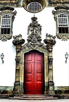 """""""I was told that one way to tell the status of a church in Sao Joao Del Rei, Brazil is by how ornate the main entry is. This entryway is one of the most ornate I found."""" By Bob Wall on redbubble.com In this town of approximately 80,000, there are over 70 churches in town; from very small and plain, to large and ornate. This isn't the largest or fanciest church in town, but it is close."""