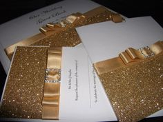 These are wedding invitations but they are going to be next years Christmas cards. Now imagine red glitter instead of gold and black ribbon and a fancy buckle for Santa's belt. All done on card stock and printed with whatever you want it to say straight from your own computer.