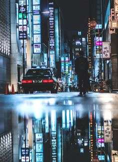 Puddle Reflections In Ginza Tokyo