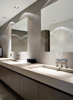 Sleek bathroom in neutral tones with extra large sinks in corian//