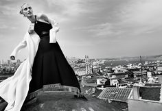 Model Julia Nobis tries on all the best coats of the season on wmag.com.