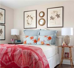 I love the headboard, botanical prints, and small round metallic mirrors.