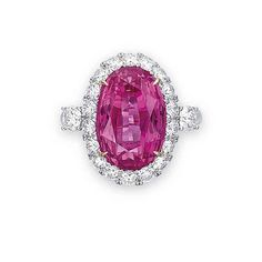 A PINK SAPPHIRE AND DIAMOND RING sold 269,370 USD at Christies Auction Hong Kong. Set with an oval-shaped pink sapphire weighing 12.07 carats, within a brilliant-cut diamond surround and shoulders, mounted in 18k white and rose gold ring.