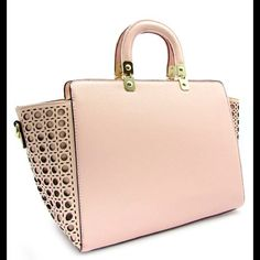 "A whisper in Blush. A classic bag in the most luscious color.  Take this on your next job interview or pair with jeans, boots and blazer. Zip top.  Rear zip pocket.  Lined. Open and zip areas inside.   11"" handles.  48"" strap included.  17x7x 10. Bags"