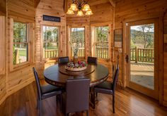 Octagon shaped dining room with timber frame roof and large expansive windows