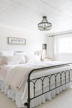 Light + Airy Farmhouse Summer Bedroom Tour | www.makingitinthemountains.com #farmhousebedroom #farmhousestyle #neutralbedroom #summerbedroom #linenbedding
