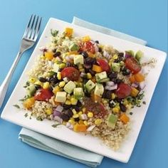 Quinoa and Black Bean Salad Recipe -This good-for-you dish is full of must-have Southwestern flavors. You can either serve it cold as a side for eight people or warm as an entree for four. The lime vinaigrette brings it all together. —Yvonne Compton, Elkton, Oregon