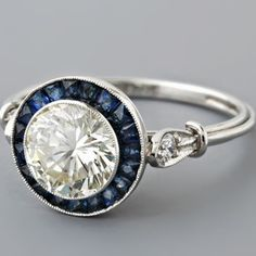 """Vintage Sapphire Ring- I LOVE the Blue Sapphires in this ring.They may be somewhat """"included,"""" but These just have such GORGEOUS color, and I like that they are rather opaque, thus, more appropriate for a more casual, easy-going gal than stones that do nothing but sparkle. Not to offend anyone, I just find them very attractive, especially in this cut, setting, and on the simpler band. :)"""