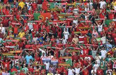 Portugal fans pose prior to the Group G football match between Germany and Portugal at the Fonte Nova Arena in Salvador during the 2014 FIFA World Cup on June 16, 2014. (DIMITAR DILKOFF/AFP/Getty Images)