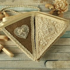 Burlap and lace vintage style wedding bunting with romantic lace heart embellishments