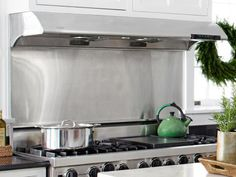 """Peter paired a residential Viking range with a commercial-grade Zephyr hood, which has an extra-powerful exhaust fan. """"The best beef and fish dishes need to be seared at a super-high heat to make a delicious crispy crust,"""" he says. """"But only the best hoods can handle the amount of smoke that emits."""""""