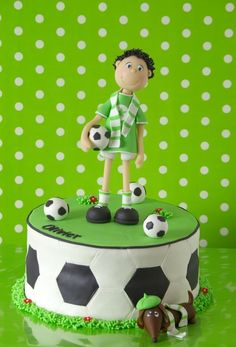 Football cake. Soccer. Boy gumpaste figure