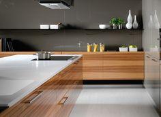 Beautiful display of horizontal woodgrain and earthy tones. Modern Kitchens