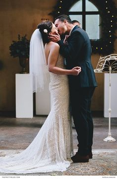 Crafted in New York, this bride's gown featured a geometric lace pattern, and boasted a sexy mermaid silhouette that flaunted her figure. | Photographer: Charlie Ray Photography | Wedding Dress Supplier: LOCA Bridal