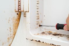 A high-humidity bathroom provides an ideal environment for rust to form on unprotected metal surfaces, such as a metal medicine cabinet with peeling paint. Rust forms when iron in the metal combines with oxygen from moisture in the air to form iron oxide. You can find many products at hardware stores to dissolve rust, but you probably don't need to...