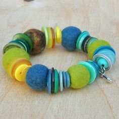 "felt jewelry | Folksy :: ""blue tit. bracelet of felt balls and buttons""--neat idea to layer felt with buttons"