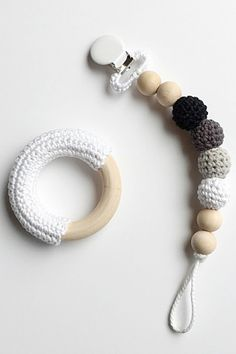 Keeps baby's pacifier attached to their clothes so you never lose it! - Organic cotton crochet over wooden balls - Safe for teething - One side clips to clothing, the other side hold the pacifier - Ea