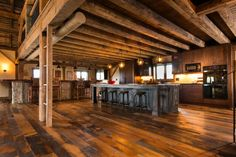 This home takes using reclaimed wood to the next level. Those beams are stunning. #homeinspiration