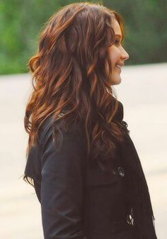 I love her hair color in Catching Fire. Dark, almost black, brown and red tones showing.