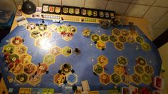All Settlers of Catan major expansions played together: Seafarers, Cities & Knights, Traders & Barbarians, Explorers & Pirates and the base game.