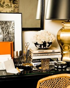 I like the flower arrangement (Suzie: Eddie Ross - Amazing office vignette with gold lamp, glossy black desk and orange accents.