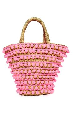 The wicker, straw, and raffia bag is an It girl staple. Shop our favorite bags from this trend on site. We love this Mystique Pom Pom Tote Straw Beach Tote, Straw Tote, Beach Tote Bags, Straw Handbags, Pink Handbags, Tote Handbags, Pink Tote Bags, Tote Purse, Kendall And Kylie
