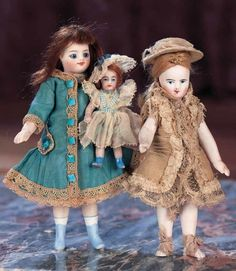 And Seem to Walk on Wings and Tread in Air: 252 French All-Bisque Mignonette with Blue Boots and Little Doll