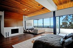 designed by interior illusions master bedroom fireplace sitting area reclaimed wood rustic modern midcentury grey white