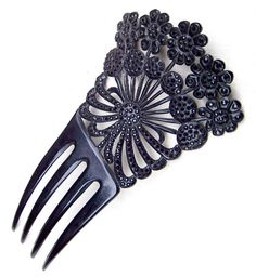 "A large and beautiful Victorian mourning hair comb in black vulcanite with French Jet stones  CONDITION: good vintage condition  SIZE: 6 ins h x 3½ ins w (15 x 9 cms)  MATERIALS: celluloid, French Jet  APPROXIMATE DATE: 1880s – 1900s  Here is a striking mourning comb which is made from black celluloid and set with French jet ""stones"". French jet is a glittering form of black glass which was produced mainly in Bohemia, now part of modern Czechoslovakia, in the late 19th and early 20th…"
