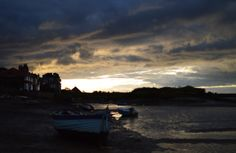 Ominous storm clouds looming over Burnham Overy Staithe