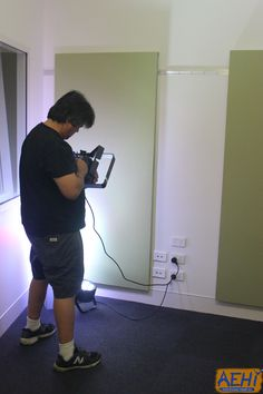 Our lighting technician setting up the set for one of our film shoots. #aehiqld #bananaflavouredmilk #bfm