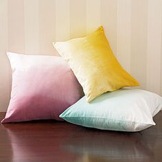 $10 Crafts to Update Your Home, Dip-Dye Pillows | http://www.rachaelraymag.com/fun-how-to/makeover-old-stuff/3/